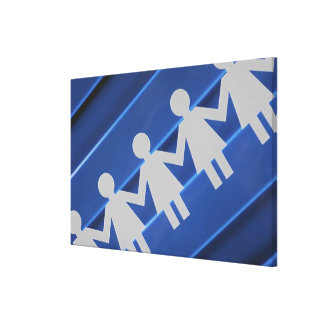 Close-up of paper chain dolls canvas print