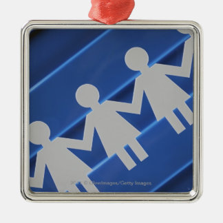 Close-up of paper chain dolls metal ornament