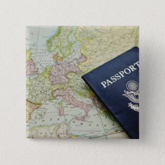 Close-up of passport lying on European map Button