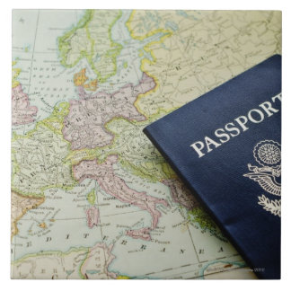 Close-up of passport lying on European map Ceramic Tile