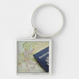 Close-up of passport lying on European map Keychain