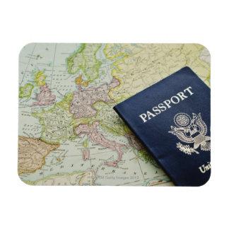Close-up of passport lying on European map Magnet