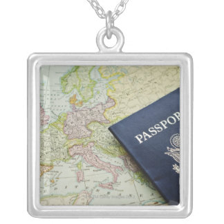 Close-up of passport lying on European map Necklaces
