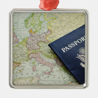 Close-up of passport lying on European map Square Metal Christmas Ornament