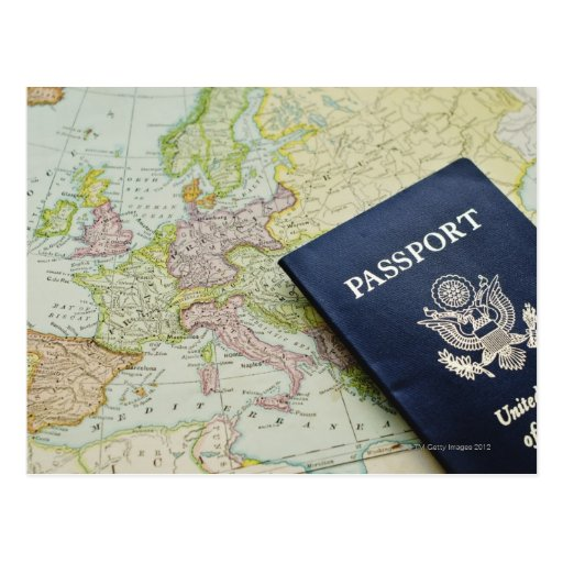 Close-up of passport lying on European map Postcard