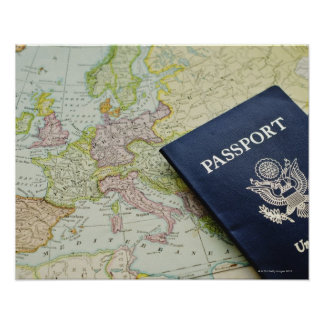 Close-up of passport lying on European map Poster