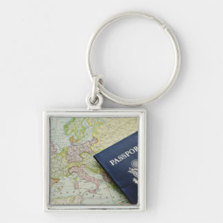 Close-up of passport lying on European map Silver-Colored Square Keychain