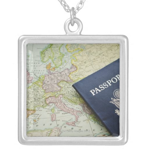 Close-up of passport lying on European map Square Pendant Necklace