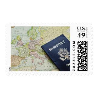 Close-up of passport lying on European map Stamp