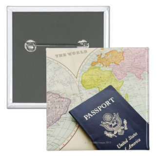 Close-up of passport lying on map pins