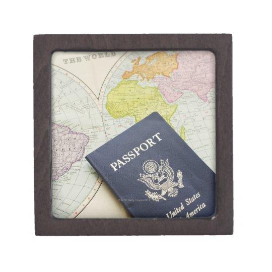 Close-up of passport lying on map gift box