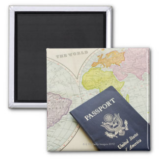 Close-up of passport lying on map magnet