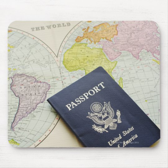 Close-up of passport lying on map mouse pad