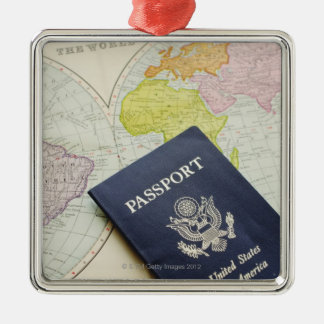 Close-up of passport lying on map christmas ornaments