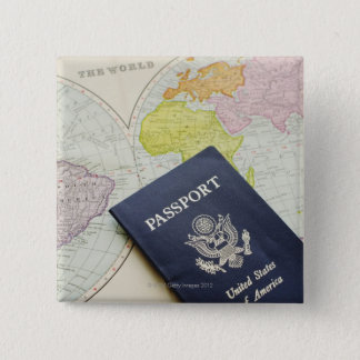 Close-up of passport lying on map pinback button