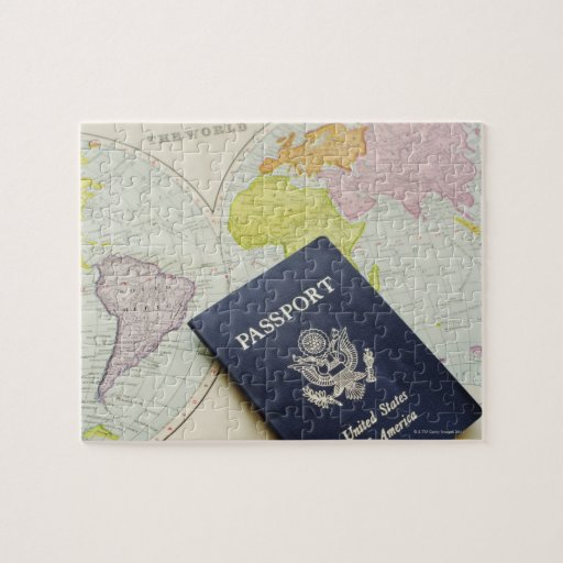Close-up of passport lying on map puzzle