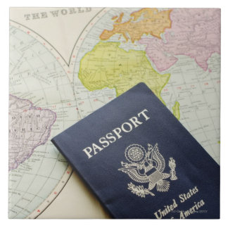 Close-up of passport lying on map tile