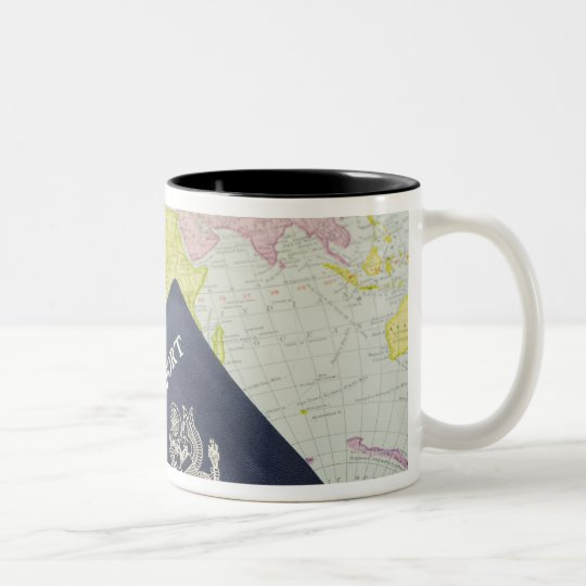Close-up of passport lying on map Two-Tone coffee mug