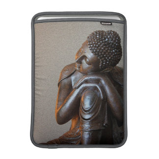 Close up of peaceful silver Buddha MacBook Sleeves