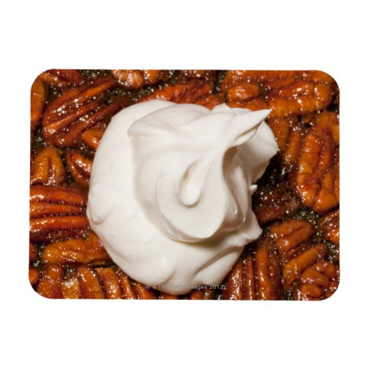close up of pecan pie with whipped cream magnet
