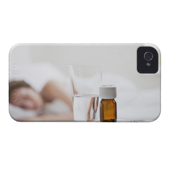 Close up of pill bottle with sick woman in Case-Mate iPhone 4 case