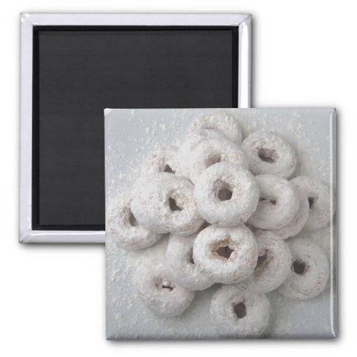 Close-up of powdered doughnuts in a plate fridge magnet