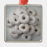 Close-up of powdered doughnuts in a plate metal ornament