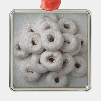 Close-up of powdered doughnuts in a plate square metal christmas ornament
