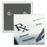 Close up of prescription pad and pen button