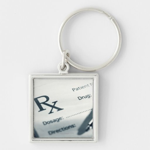 Close up of prescription pad and pen Silver-Colored square keychain