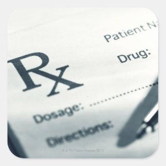 Close up of prescription pad and pen square sticker