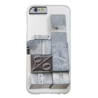 Close up of printing blocks with percentage sign barely there iPhone 6 case