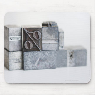 Close up of printing blocks with percentage sign mouse pad