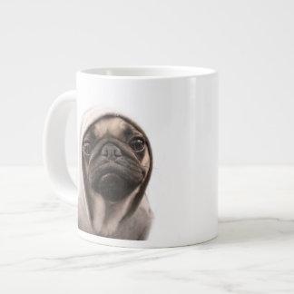 Close up of pug wearing hoodie. giant coffee mug