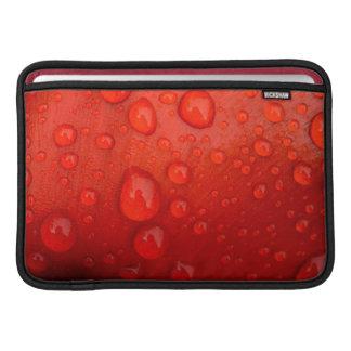 Close-up of raindrops on tulip petal MacBook sleeve