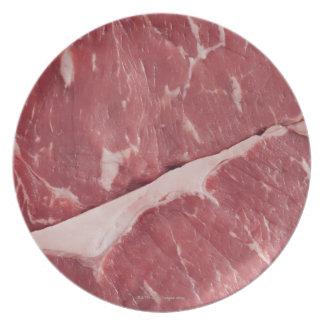Close-up of raw steak dinner plate