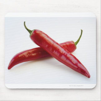 Close up of red chili peppers on white mouse pad
