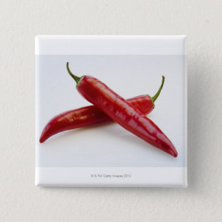 Close up of red chili peppers on white pinback button