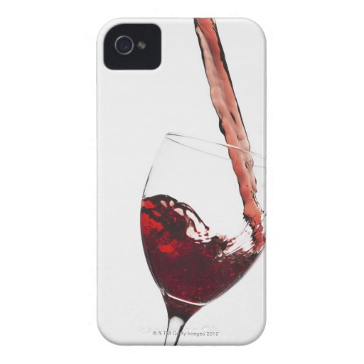 Close up of red wine being poured into glass on blackberry case