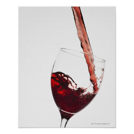 Close up of red wine being poured into glass on poster