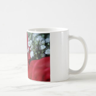 Close up of rose and baby's breath coffee mug