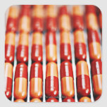 Close up of rows of pill capsules square sticker