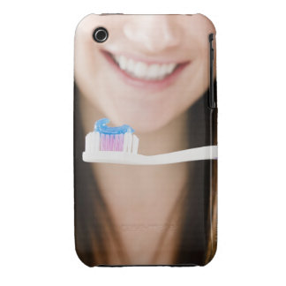 Close-up of smiling young woman holding Case-Mate iPhone 3 cases