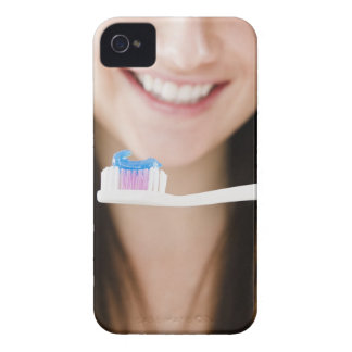 Close-up of smiling young woman holding iPhone 4 Case-Mate case