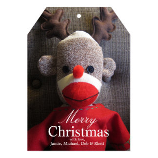 Close-up of sock monkey face with antlers, red card