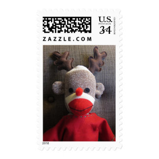 Close-up of sock monkey face with antlers, red stamp