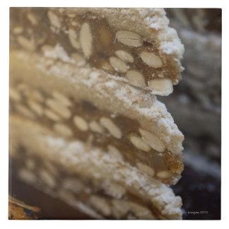 Close up of stack of panforte. This dense, flat Tile