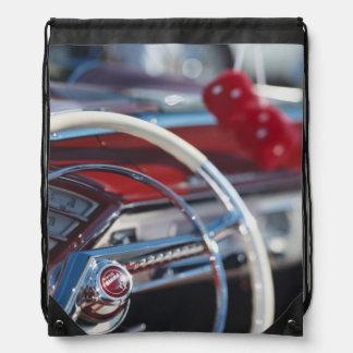 Close-up of steering wheel in classic car drawstring bag