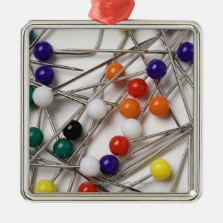 Close-up of straight pins square metal christmas ornament