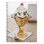 Close up of sundae with cherry on top notebook